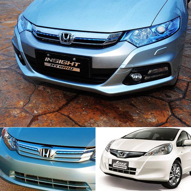 细长的发动机进气格栅采用镀铬装饰,格栅中间除了H本田厂徽以外,还嵌入了一条浅蓝色饰条,这条浅蓝色饰条在某种程度上可以称得上是本田混合动力车型的标志,在Civic Hybrid(下左)以及Jazz Hybrid(下右)等车型上都能发现。