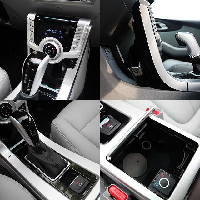纳智捷5的中控台采用了类似沃尔沃的悬浮式面板,在面板后方还具有安放智能手机的插槽(图右上)。而在排挡杆和电子手刹的后方,纳智捷5的杯架同时具备冷冻与加热功能,温控范围达到5℃-55℃。(图右下)
